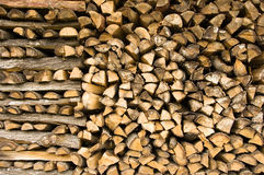 Firewood. Detail of a stack of firewood stock image