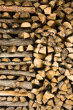 Firewood. Detail of a stack of firewood royalty free stock photo