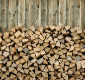 Firewood. Pile of firewood against old wooden fence Stock Photos