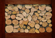 Firewood. Large pile of firewood logs in big compartment Stock Photo