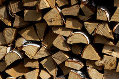 Firewood. Stack of wood in the background Stock Photography
