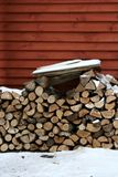 Firewood. Near the wall in winter stock photography