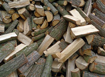 Firewood. Lot of firewood on a grist Royalty Free Stock Photography