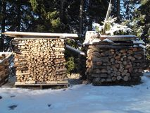 The Firewood arranged in the form of the cube Royalty Free Stock Photos