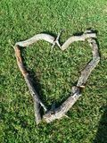 Firewood art on my lawn Stock Photos
