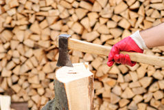 Firewood with axe Royalty Free Stock Images