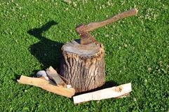 Firewood and axe Stock Image