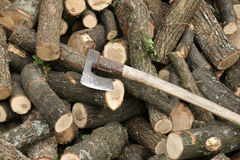 Firewood and axe Royalty Free Stock Images