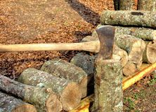 Firewood with axe in log Royalty Free Stock Image