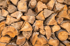 Firewood background - chopped firewood on a stack Royalty Free Stock Images