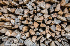 Firewood background - chopped firewood on a stack Stock Photography