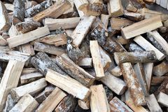Chopped snowy firewood logs in a pile royalty free stock photography