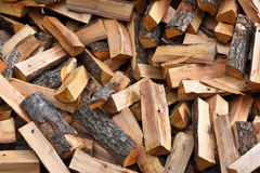 Firewood background - chopped firewood on a stack Royalty Free Stock Image