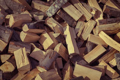 Firewood background - chopped firewood on a stack Royalty Free Stock Photography