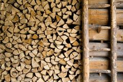Firewood in a barn Stock Images