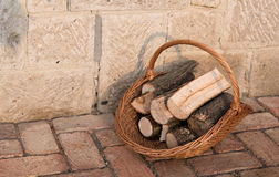 Firewood in basket Stock Photos