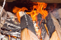 Firewood blaze in ryral stove from brick.Alternative energy sour Royalty Free Stock Photos