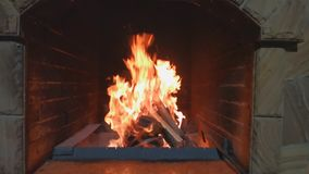 Firewood and branches for coals burn out in stone firepit brazier.  stock video footage