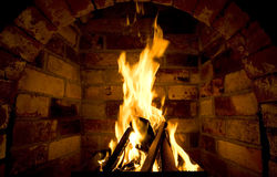 Firewood burn in furnace bricks. Firewood burn in furnace, made from bricks Stock Images