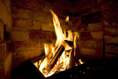 Firewood burn in furnace bricks. Firewood burn in furnace, made from bricks Royalty Free Stock Photos