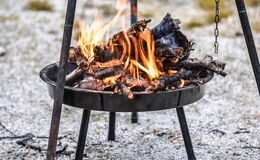 Firewood Burning in Black Steel Round Tray Royalty Free Stock Photo