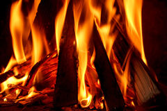 Firewood burning in fireplace Stock Images