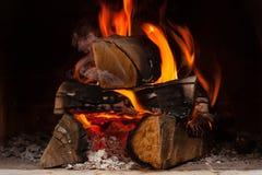 Firewood. Burning at the fireplace close up Stock Photos