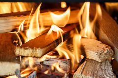 Firewood burning in fireplace Royalty Free Stock Photography