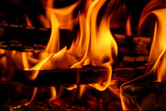 Firewood burning in fireplace. Close up of firewood burning in outdor fireplace Royalty Free Stock Image