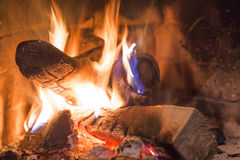 Firewood burning in fireplace Royalty Free Stock Images