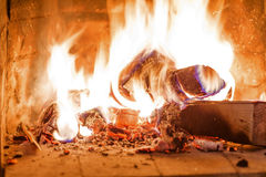 Firewood burning in fireplace fire wood heat Stock Image
