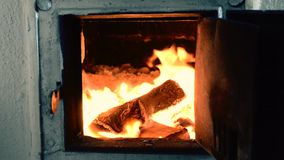 Firewood burning in furnace stock video