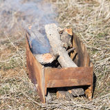 Firewood is burning in the grill Royalty Free Stock Photography