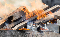 Firewood is burning in the grill Royalty Free Stock Photos