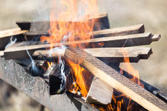 Firewood is burning in the grill Stock Image