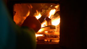 Firewood burning in the village oven Stock Image