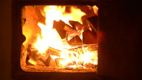 Firewood burning in the village oven Royalty Free Stock Photography