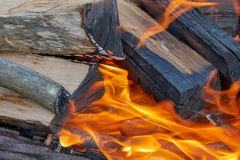 Firewood burns brightly in the grill royalty free stock image