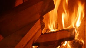 Firewood burns in the fireplace. Home heat stock footage