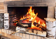 Firewood burns in the home furnace Royalty Free Stock Image