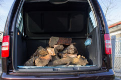 Firewood in the car Royalty Free Stock Photos