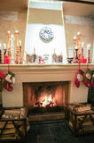 Firewood in the Christmas fireplace. Stock Photo