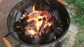 Firewood and coals, brightly burning in the barbecue. Firewood and coals, brightly burning in the barbecue in the backyard. Close-up stock video footage