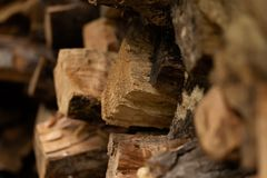 Firewood in Woodpile. Firewood of different deciduous trees in a woodpile royalty free stock photo