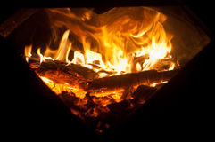 Firewood in fire Stock Images