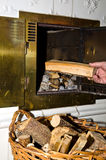 Firewood into fireplace Royalty Free Stock Photos