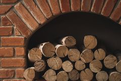Firewood in the fireplace. Firewood in the brick fireplace stock images