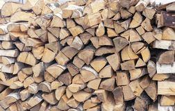Firewood for a fireplace stacked in a woodpile stock photo