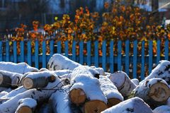 Firewood. Covered with snow near home Royalty Free Stock Photo