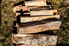 Firewood on the ground. Laying firewood before fireing the barbeque stuff Royalty Free Stock Image